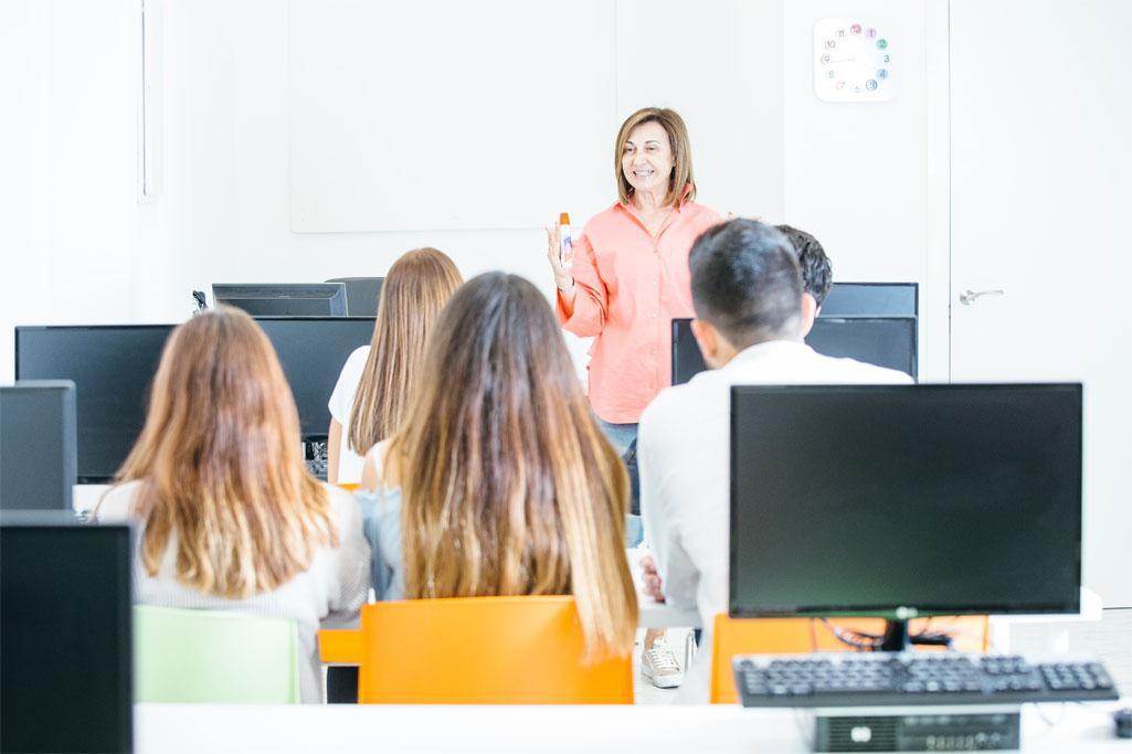 cheerful tutor teaching students