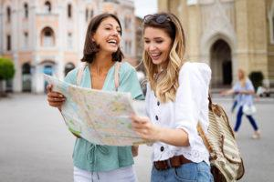 happy traveling tourists sightseeing with map in h pu4b837